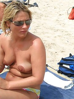 Babes With Puffy Nipples On The Beach Pics